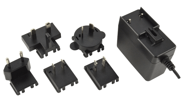 Level VI Compliant Ac-Dc Power Supplies Feature Interchangeable Input Blades for Global Use
